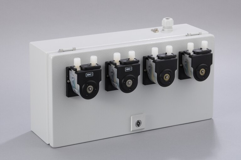 Oblique view of 4 Peristaltic Pumps SR25.1/Ex-G in a stainless steel enclosure